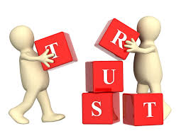 "generic human images with building blocks spelling the word ""trust:"""